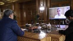 Tehran's Mayor Pirouz Hanachi (L) and Mayor of London Sadiq Khan speak via a video link-up on April 24, 2020. (Photo by IRNA)