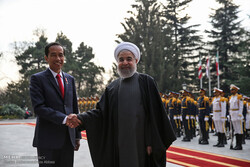 Widodo shaking hand with Rouhani during an official visit to Tehran in mid-Dec. 2016