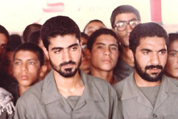 Commander Qassem Soleimani (L) among a group of volunteers on the frontline during the 1980-1988 Iran-Iraq war.