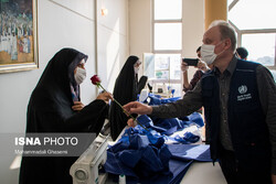 WHO representative visits face mask production center in Tehran