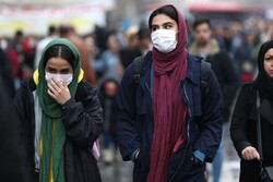 Iranian women wear protective masks to prevent contracting a coronavirus, as they walk at Grand Bazaar in Tehran, Iran February 20, 2020. (Photo credit: Reuters)