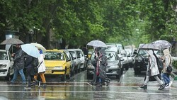 Frequent rain falls in April bring out the umbrellas and rain jackets in Tehran.