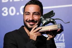 """Navid Mohammadzadeh poses with the Orizzonti Award for Best Actor for his role in """"No Date, No Signature"""" at the award winners photocall during the 74th Venice Film Festival"""