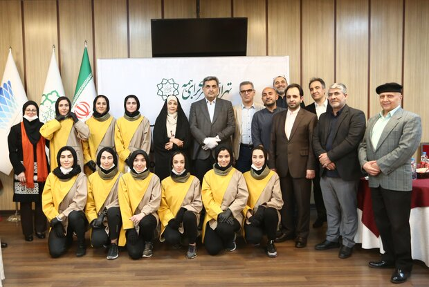 """Crew members of """"No Place for Angels"""" about the national Iranian women's hockey team, Tehran Mayor Piruz Hanachi and some DEFC officials pose after a screening of the documentary at Milad Tower on May"""