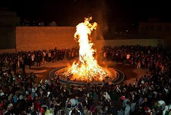 File photo depicts Zoroastrian followers observing Sadeh festival to recall the mythical discovery of fire.