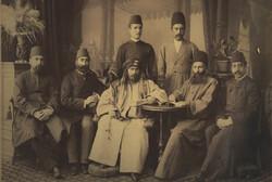 This picture shows Persian businessman Hajj Mohammad-Hossein Mahdavi – Amin al-Zarb sitting in the center.