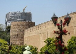 File photo depicts the centuries-old Arg-e Karim Khan with a modern hotel being constructed in the background, distorting general views of the brick fortress in Shiraz, southern Iran.