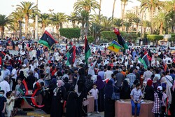 Celebrating with Libyan national flags in Tripoli in early June after fighters loyal to the U.N.-backed government captured the town of Tarhuna from rival forces loyal to the commander Khalifa Hifter. (Photo: Agence France-Presse — Getty Images)