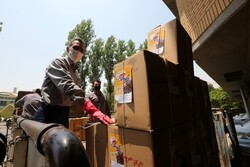 """Workers load packages of donated books for the plan """"It's Possible by Books"""" in Tehran on July 5, 2020."""