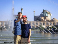 Foreign travelers take a selfie during the visits to the UNESCO-registered Imam Square in Isfahan, central Iran.