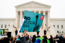 Protesters outside the Supreme Court in April 2018. (Credit: Andrew Harnik/Associated Press)