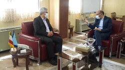 Deputy Minister of Cultural Heritage, Tourism, and Handicrafts Vali Teymouri (L) meets with MP Mohammadreza Dashti Ardakani in Tehran on August 10, 2020.