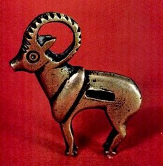 An Iranian bronze padlock in the shape of a ram