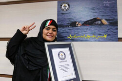 Iranian swimmer Elham Sadat Asghari holds her Guinness World Record Certificate in an undated photo.