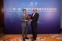 Tehran's Ambassador to Beijing Mohammad Keshavarz-Zadeh (R) stands by a Chinese official during a meeting on the collective intangible cultural heritage nations have along the ancient Silk Road.