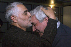 Lieutenant-General Qassem Soleimani kisses filmmaker Ebrahim Hatamikia in an undated photo.