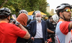Deputy Ambassador of the Netherlands to Tehran, Andre van Wiggen (C) is surrounded by cyclists in downtown Tehran on September 22, which marks World Car-Free Day. On this day, ambassadors of four European countries to Tehran along with the city's mayor Pirouz Hanachi rode bicycles on the streets.
