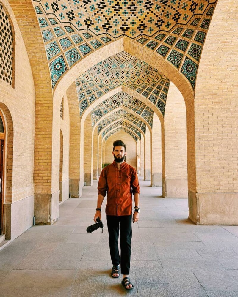 Turkish photographer Berke Arakli poses for a photo during his visit to Nasir al-Molk Mosque in Shiraz in August 2019
