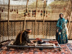 Nomads are seen at a carpet production workshop outside Shiraz, southern Iran (Credit: The New York Times)
