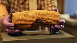 The Cyrus Cylinder, seen from the back, during installation at the Getty Villa. Achaemenid, after 539 B.C. Terracotta, 22.9 x 10 cm. The British Museum