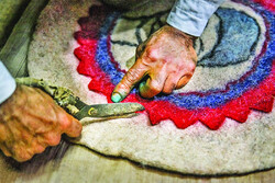 Rough hands, wool fibers and the traditional art of felt