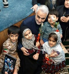 A file photo shows Commander Qassem Soleimani greeting several children of Iranian soldiers martyred by the ISIS terrorists in Syria.