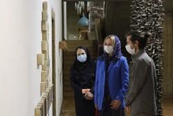 Italian diplomat Yaroslava Romanova (C) and the organizers visit the 11th National Biennial of Contemporary Iranian Ceramic Art at Tehran's Niavaran Cultural Center.