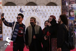 Iranian filmmakers Afshin Hashemi (2nd L) and Narges Abyar (2nd R) pose with Afghan fans for a selfie during the closing ceremony of the 6th Herat International Women's Film Festival