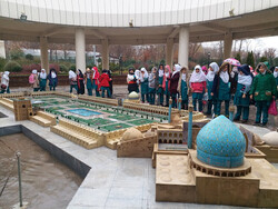 Students visit a giant model of the UNESCO-registered Imam Square at Tehran's Miniature Garden Museum.