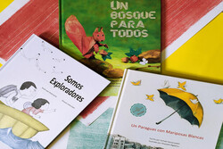 Copies of three books by Iranian writers published in Spanish by the La Maleta publishing house in Asturias, Spain.