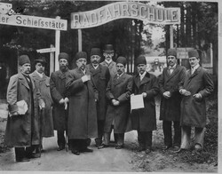 Qajar king Mozaffar ad-Din Shah (4th L) and a number of Iranian officials pose in front of a cycling school in their visit to Europe.