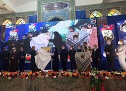 "IRGC chief Hossein Salami and Zeinab Soleimani, daughter of Commander Qassem Soleimani, unveil copies of Afshin Ala's poetry book ""Sarbaznameh"" at Imam Ali (AS) Mosalla in Kerman on January 7, 2021. ("