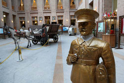 An interior view of the Post and Communications Museum in downtown Tehran. An statue of an Iranian postman is also seen in the foreground.
