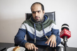 Iranian filmmaker Vahid Farahani attends an interview with the Tehran Times.