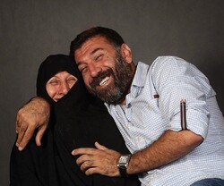 Actor and former footballer Ali Ansarian pose with his mother in an undated photo.