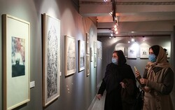 Art enthusiasts visit an exhibition of prints by Iranian and foreign artists during the 13th Fajr Festival of Visual Arts at the Saba Art and Cultural Institute in Tehran on February 6, 2021. (Tasnim/