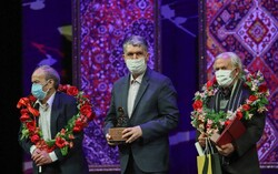 Musicians Hassan Nahid (L) and Mohammareza Es'haqi Gorji (R) accept their lifetime achievement awards from Culture Minister Seyyed Abbas Salehi (C) at the closing ceremony of the 36th Fajr Music Festi