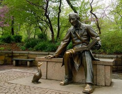 """A statue in Central Park, New York commemorating Hans Christian Andersen and """"The Ugly Duckling""""."""