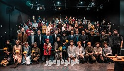 "Ukrainian Ambassador Serhii Burdyliak and his colleagues pose for a photo with the Seganeh Troupe after the performance of ""Holodomor"" at Tehran's Neauphle-le-Chateau Theater on March 5, 2021."