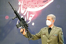 Defense Minister Hatami shows locally-made modern shooting gun