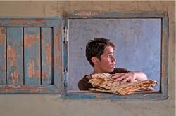 """Ruhollah Zamani acts in a scene from director Majid Majidi's """"Sun Children""""."""