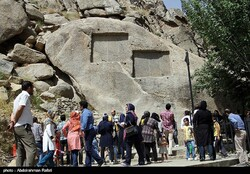 File photo depicts people visiting the Achaemenid site of Ganjnameh in Hamedan before the  coronavirus crisis.
