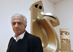 Iranian sculptor Parviz Tanavoli poses with a work from his Heech series in a file photo.