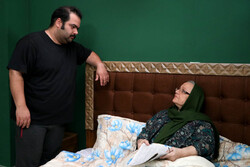 "Soheil Qannadan (L) and Nahid Haddadi act in a scene from ""The Son"" directed by Nushin Meraji."