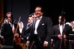 Maestro Ali Rahbari conducts the Tehran Symphony Orchestra in an undated photo. (Mehr/Hossein Esmaeili)
