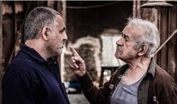 """Mani Haqiqi and Saeid Pursamimi act in a scene from """"Amphibious"""" by Borzu Niknejad."""