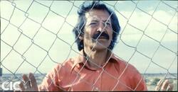"Siamak Atlasi acts in a scene from director Kianush Ayyari's 1987 classic ""Beyond the Fire""."