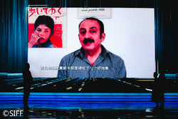 ranian director Abolfazl Jalili speaks to the audience in a video after winning the Golden Goblet for best Director during the closing ceremony of the Shanghai International Film Festival in China on