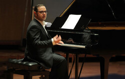 This file photo shows Iranian pianist Puyam Azadeh giving a recital.