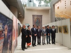 Iranian cultural attache Hossein Divsalar (3rd L) and Japanese artist visit the Iran-Japan Cultural Exchange Exhibition in Tokyo on July 1, 2021.